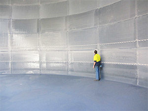 Interior lining of steel panel tanks