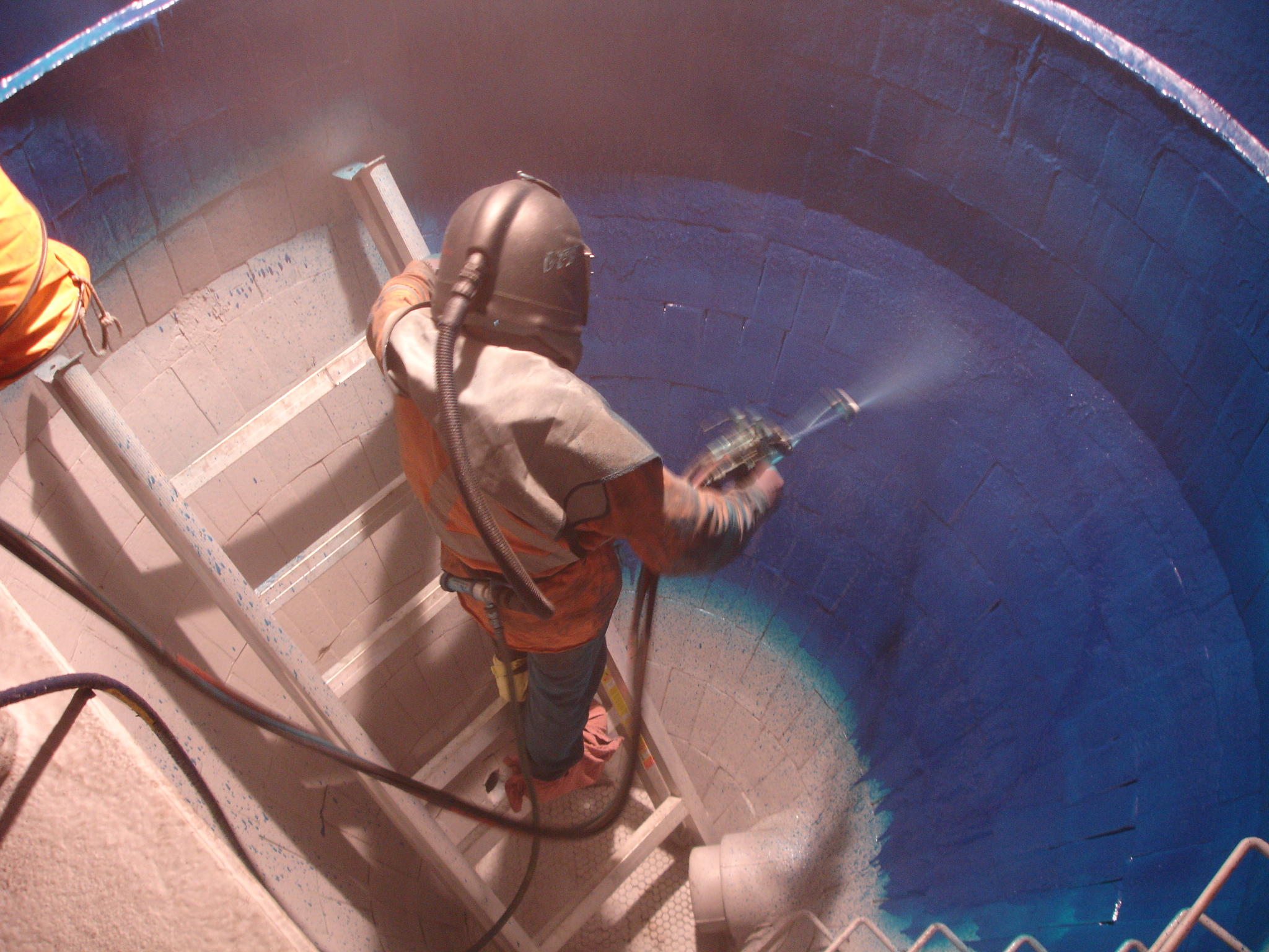 Coal Mine wash tank being sprayed with Tufflon