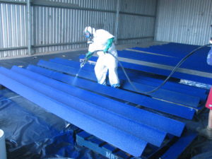 Steel beams being sprayed with Tufflon Corrosion prevention